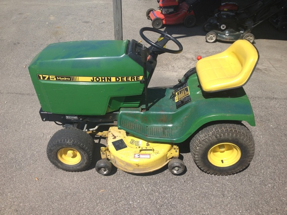 how to change blades on john deere riding mower